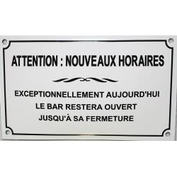Plaque émaillée humoristique : ATTENTION : NOUVEAUX HORAIRES.
